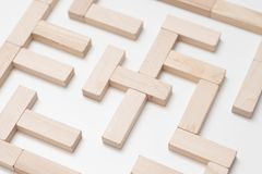 Logical thinking strategy quest solution maze. Logical thinking. Search for solution. Life quest. Business strategy. Conceptual maze construction with wooden royalty free stock images