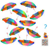 Logikpussel Fynd två identiska paraplyer Arkivfoton