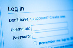 Login blue toned. Login and password on computer internet account screen Stock Image