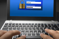 Login and Password Screen. Closeup of a hand typing on laptop keyboard in login interface royalty free stock photos