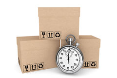 Logistic concept. Stopwatch and boxes Royalty Free Stock Photos