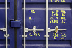 Logistic and Distribution. A industrial cargo container foreground Royalty Free Stock Photos