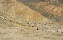 Logistic in Himalayas. Group of trucks transport goods and food in Himalayas during summer. The roads can be used in short period for one year Stock Images
