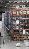 Logistic shed and distribution boxes workers and forklift in operation. Rack stock photos