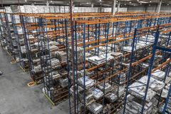 Logistic shed and distribution boxes workers and forklift in operation. Rack royalty free stock photos