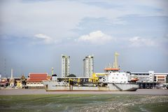 Logistic ship stop wait water level up at estuary of Chao phraya river Stock Photos
