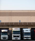Logistic transport trucks on loading bay Royalty Free Stock Photos