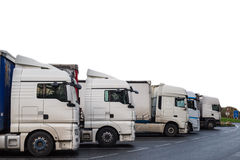 Logistic transportation trucks for delivery. To cargo in twilight time Royalty Free Stock Images