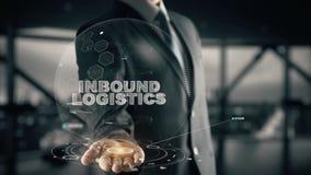Logistica in arrivo con il concetto dell'uomo d'affari dell'ologramma Immagini Stock Libere da Diritti