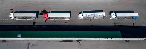 Logistics center aerial view from above. Trucks on loading royalty free stock photos