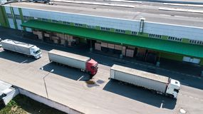 Logistics center aerial view from above. Trucks on loading royalty free stock image