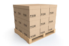 Logistics concept. Cardboard boxes on wooden palette Stock Photography