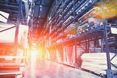 Logistics concept. Huge industrial warehouse, business shipping and cargo storage for export, pallets with goods. On shelves, perspective, blue toned with stock image