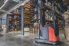Logistics concept. Huge industrial warehouse, business shipping and cargo storage for export, pallets with goods on shelves. Perspective stock images
