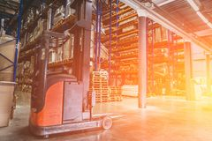 Logistics equipment, Large hangar warehouse with lots shelves or racks with pallets of goods. Industrial shipping and cargo. Delivery distribution concept royalty free stock photography