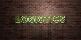 LOGISTICS - fluorescent Neon tube Sign on brickwork - Front view - 3D rendered royalty free stock picture Stock Image