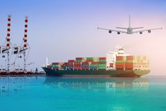 Logistics and international shipping containers, cargo ship and air planes. In the blue sky, ocean freight transportation and crane in port on sunset background royalty free stock images