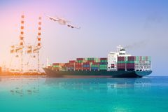 Logistics and international shipping containers, cargo vessels and air planes. In the ocean freight transportation port with crane in harbor and Stern ship view royalty free stock photos