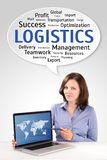 Logistics manager is showing world map on a laptop screen. Under technology wordcloud, business concept royalty free stock photography