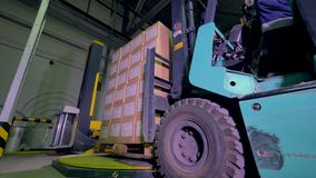 Logistics and shipping facility. Forklift move boxes and goods in warehouse. 4K. Logistics and shipping facility. Forklift move boxes and goods in warehouse stock footage