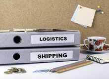 Logistics and Shipping - two folders on white office desk Royalty Free Stock Images