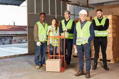 Logistics team with sack truck in a warehouse stock image
