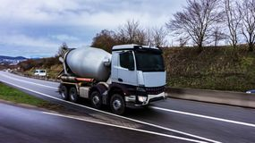 Cement mixer truck motion. Logistics transport . the truck goes to building stock photo