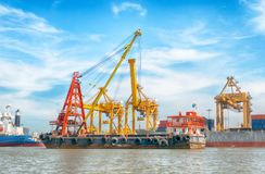 Logistics and transportation of container cargo ship. With working crane bridge in shipyard at sunrise, logistic import export concept and transport industry Royalty Free Stock Photography