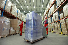 Logistics - workers in storehouse Stock Photo