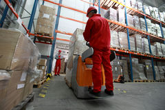 Logistics workers at work in storehouse