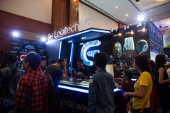Logitech in Indo Game Show 2013. Jakarta, Indonesia, 8th September 2013: Visitors trying out Logitech PC peripherals like keyboards, mouses, and headphones on Royalty Free Stock Image