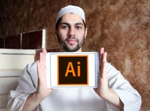 Adobe Illustrator logo. Logo of Adobe Illustrator on samsung tablet holded by arab muslim man. Adobe Illustrator is a vector graphics editor developed and stock photo