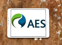 AES energy corporation logo. Logo of AES energy corporation on samsung tablet on wooden background. The AES Corporation is a Fortune 200 company that generates Stock Photography