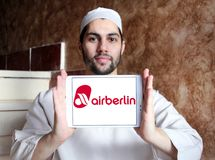 Air Berlin logo. Logo of Air Berlin on samsung tablet holded by arab muslim man. Air Berlin is Germany second largest airline and Europe tenth-largest airline in stock images