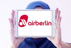 Air Berlin logo. Logo of Air Berlin on samsung tablet holded by arab muslim woman. Air Berlin is Germany second largest airline and Europe tenth-largest airline stock images