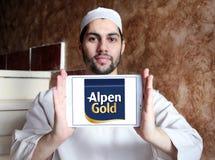 Alpen gold brand logo. Logo of alpen gold on samsung tablet holded by arab muslim man royalty free stock photo