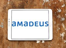 Amadeus IT Group logo. Logo of Amadeus IT Group on samsung tablet on wooden background. Amadeus is a major Spanish IT Provider for the global travel and tourism Stock Image