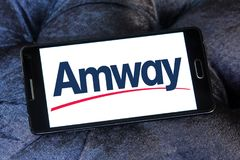 Amway company logo. Logo of Amway company on samsung mobile. Amway is an American company specializing in the use of multi-level marketing to sell health, beauty stock photo