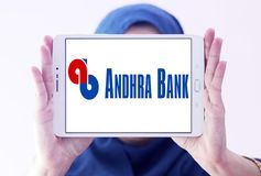 Andhra Bank logo. Logo of Andhra Bank on samsung tablet holded by arab muslim woman. Andhra Bank is a medium sized public sector bank PSB of India stock photos