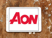 AON insurance logo. Logo of AON insurance company on samsung tablet on wooden background. Aon is a global professional services firm that provides risk Stock Photos