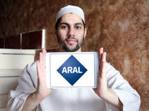 Aral oil company logo. Logo of Aral oil company on samsung tablet holded by arab muslim man. Aral is a brand of automobile fuels and petrol stations, present in Royalty Free Stock Photography