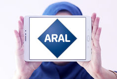 Aral oil company logo. Logo of Aral oil company on samsung tablet holded by arab muslim woman. Aral is a brand of automobile fuels and petrol stations, present Stock Photography