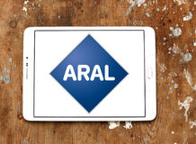 Aral oil company logo. Logo of Aral oil company on samsung tablet on wooden background. Aral is a brand of automobile fuels and petrol stations, present in Stock Photography