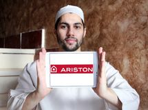 Ariston home appliances company logo. Logo of Ariston home appliances company on samsung tablet holded by arab muslim man. Ariston is suppliers of electrical Stock Image