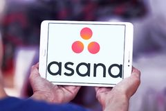 Asana software logo. Logo of Asana software on samsung tablet . Asana is a web and mobile application designed to help teams track their work Royalty Free Stock Images