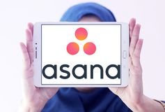 Asana software logo. Logo of Asana software on samsung tablet holded by arab muslim woman. Asana is a web and mobile application designed to help teams track Stock Photo