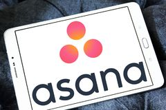 Asana software logo. Logo of Asana software on samsung tablet . Asana is a web and mobile application designed to help teams track their work Stock Images