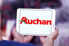 Auchan retail group logo. Logo of Auchan retailer on samsung tablet . Auchan is a French international retail group and multinational corporation stock photos