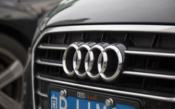 The logo of Audi on the car front Royalty Free Stock Images