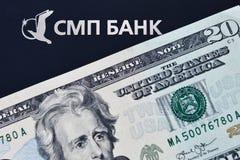 Logo av SMP banken och den 20 dollar sedeln Royaltyfri Foto